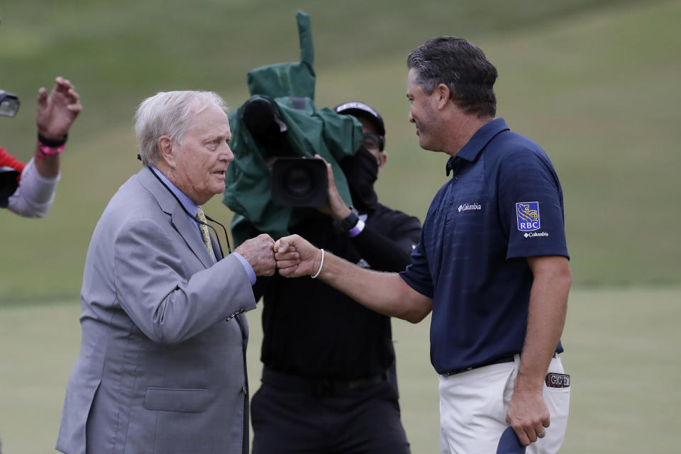 Ryan Palmer, right, fist bumps Jack Nicklaus after the final round of the Memorial golf tournament, Sunday, July 19, 2020, in Dublin, Ohio. (AP Photo/Darron Cummings)