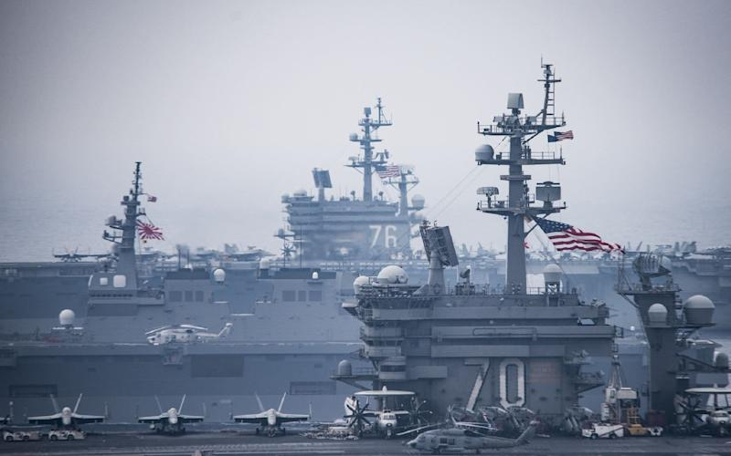 This US Navy handout photo shows the Carl Vinson Carrier Strike Group, operating with the Ronald Reagan Carrier Strike Group, which includes the USS Shiloh - Credit: AFP
