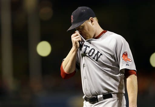 Boston Red Sox starting pitcher Aaron Cook walks off the field after being relieved in the second inning of a baseball game against the Baltimore Orioles in Baltimore, Friday, Sept. 28, 2012. (AP Photo/Patrick Semansky)