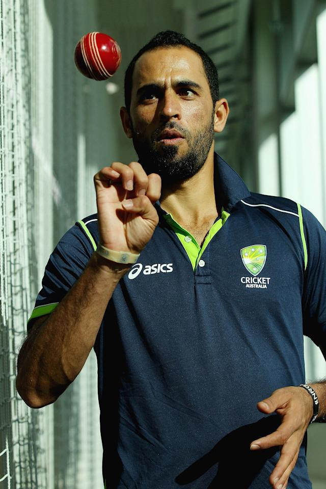 MELBOURNE, AUSTRALIA - JUNE 06:  Fawad Ahmed poses for pictures after speaking to the media during a Cricket Australia press conference at Melbourne Cricket Ground on June 6, 2013 in Melbourne, Australia. Cricket Australia today announced the inclusion of Ahmed in the Australia A tour of the British Isles.  (Photo by Robert Prezioso/Getty Images)