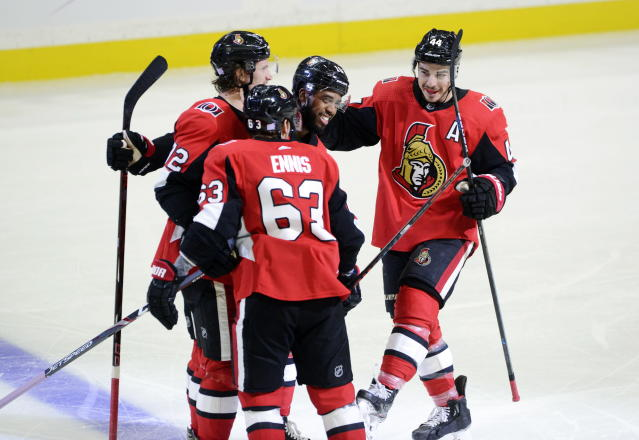 Ottawa Senators left wing Anthony Duclair, middle, celebrates his goal with teammates, from left, Thomas Chabot, Tyler Ennis and Jean-Gabriel Pageau, during the second period of an NHL hockey game against the New York Rangers on Friday, Nov. 22, 2019, in Ottawa, Ontario. (Sean Kilpatrick/The Canadian Press via AP)
