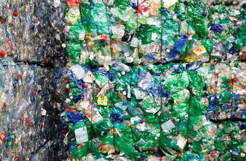 FILE PHOTO: Bundles of pressed PET bottles are seen at the Transcycle Transport & Recycling AG company in Neuenhof