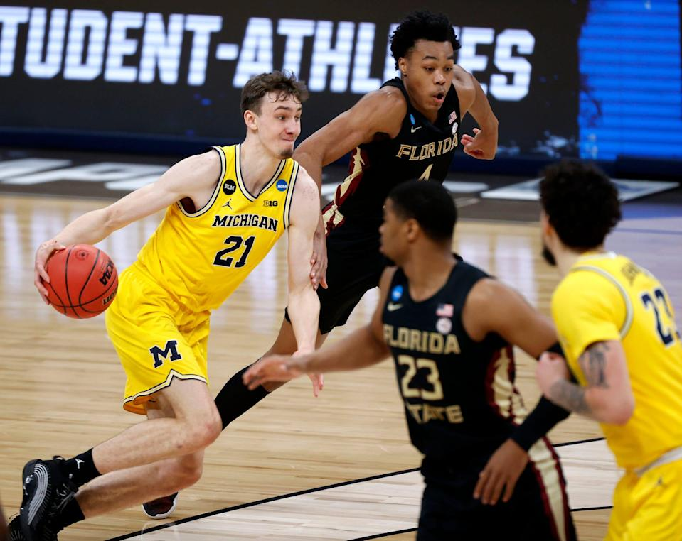 Michigan guard Franz Wagner drives past Florida State guard Scottie Barnes during the first half of a Sweet 16 game in the NCAA tournament on Sunday, March 28, 2021, in Indianapolis.