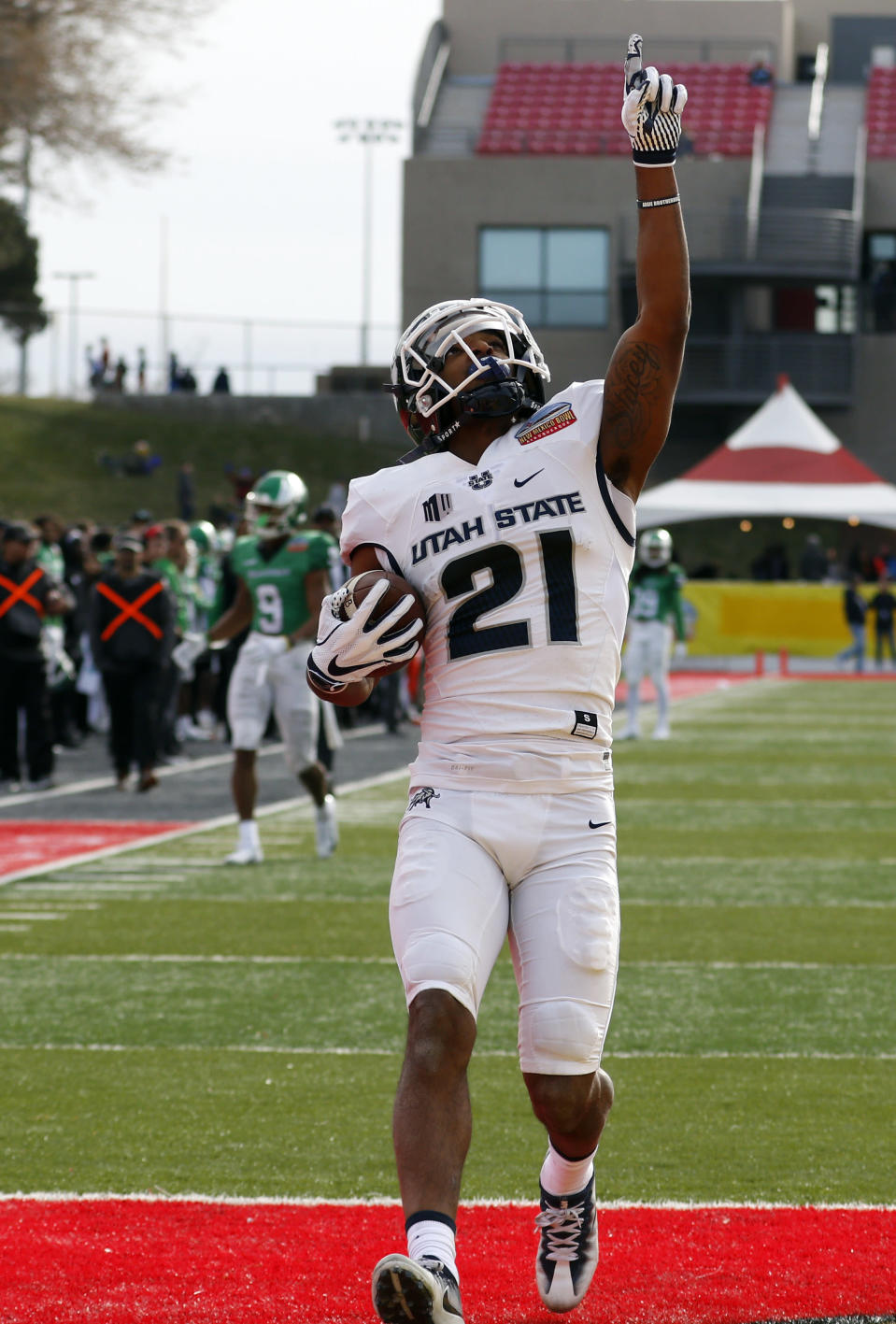 Utah State wide receiver Jalen Greene celebrates after scoring a touchdown against North Texas during the first half of the New Mexico Bowl NCAA college football game in Albuquerque, N.M., Saturday, Dec. 15, 2018. (AP Photo/Andres Leighton)