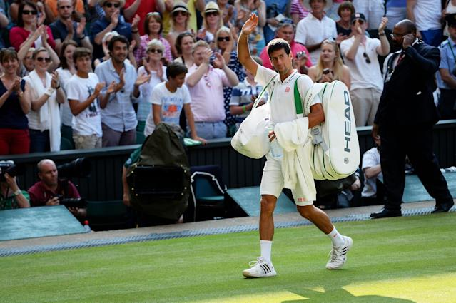 LONDON, ENGLAND - JULY 05: Novak Djokovic of Serbia waves to the crowd as he leaves Centre Court following his victory in the Gentlemen's Singles semi-final match against Juan Martin Del Potro of Argentina on day eleven of the Wimbledon Lawn Tennis Championships at the All England Lawn Tennis and Croquet Club on July 5, 2013 in London, England. (Photo by Mike Hewitt/Getty Images)