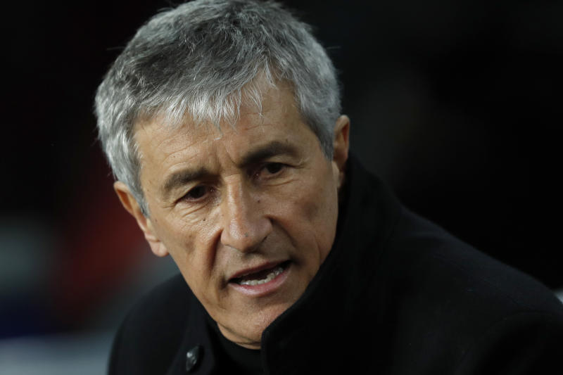 Barcelona's head coach Quique Setien sits on the bench during a Spanish La Liga soccer match between Barcelona and Granada at Camp Nou stadium in Barcelona, Spain, Sunday, Jan. 19, 2020. (AP Photo/Joan Monfort)