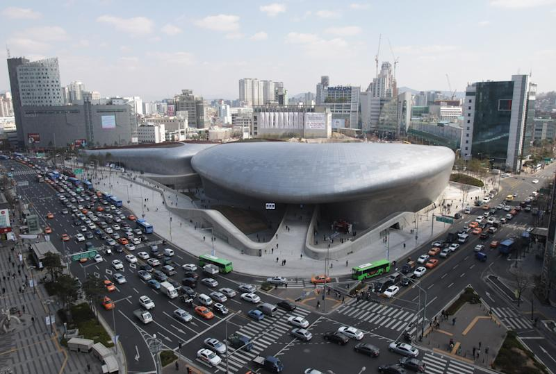 Dongdaemun Design Plaza is seen in downtown Seoul, South Korea, Friday, March 21, 2014. The $450 million building funded by Seoul citizen's tax money finally opened to public on Friday after years of debates about transforming a historic area with an ultra-modern architecture. (AP Photo/Ahn Young-joon)