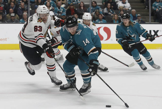 San Jose Sharks center Gustav Nyquist (14) skates with the puck in front of Chicago Blackhawks defenseman Carl Dahlstrom (63) during the first period of an NHL hockey game in San Jose, Calif., Sunday, March 3, 2019. (AP Photo/Jeff Chiu)