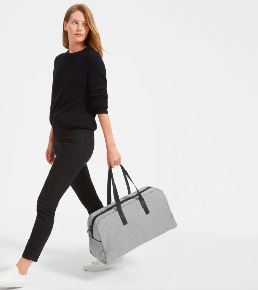 The Twill Weekender in Reverse Denim and Black Leather. Image via Everlane.