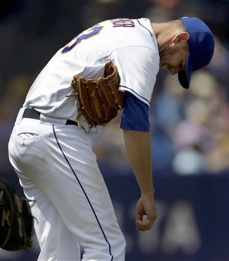 New York Mets starting pitcher Jeremy Hefner bends over after being hit by a line drive from St. Louis Cardinals' Carlos Beltran during the fourth inning of an exhibition spring training baseball game Tuesday, March 26, 2013, in Port St. Lucie, Fla. Hefner left the game. (AP Photo/Jeff Roberson)