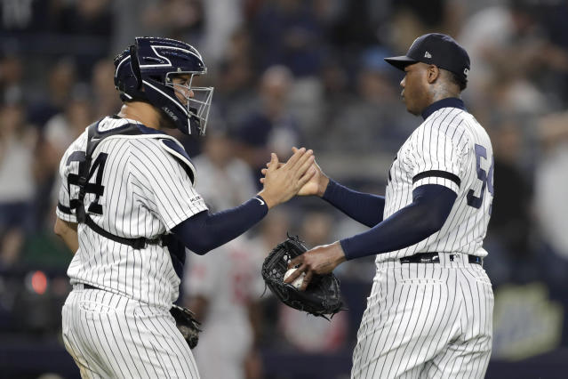 New York Yankees catcher Gary Sanchez, left, and relief pitcher Aroldis Chapman congratulate on another after the Yankees defeated the Boston Red Sox 4-1 during a baseball game Friday, May 31, 2019, in New York. (AP Photo/Julio Cortez)