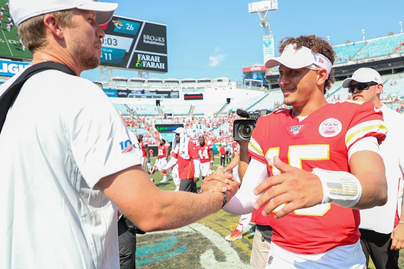 JACKSONVILLE, FLORIDA - SEPTEMBER 08: Patrick Mahomes #15 of the Kansas City Chiefs meets with Nick Foles #7 of the Jacksonville Jaguars after a game at TIAA Bank Field on September 08, 2019 in Jacksonville, Florida. (Photo by James Gilbert/Getty Images)