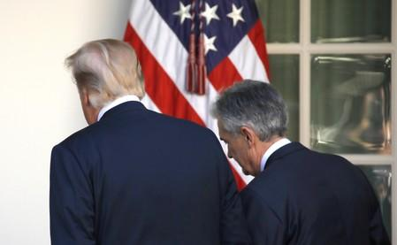 FILE PHOTO: U.S. President Donald Trump leaves the Rose Garden with Jerome Powell, his nominee to become chairman of the U.S. Federal Reserve at the White House in Washington