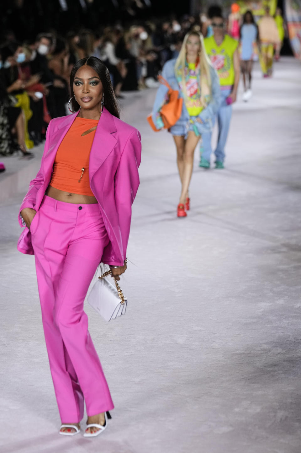 Naomi Campbell wears a creation for the Versace Spring Summer 2022 collection during Milan Fashion Week, in Milan, Italy, Friday, Sept. 24, 2021. (AP Photo/Luca Bruno)