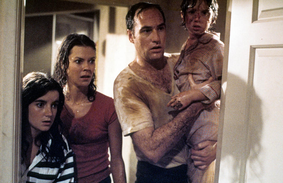 JoBeth Williams looks on as Craig T Nelson holds Oliver Robins in a scene from the film 'Poltergeist', 1982. (Photo by Metro-Goldwyn-Mayer/Getty Images)