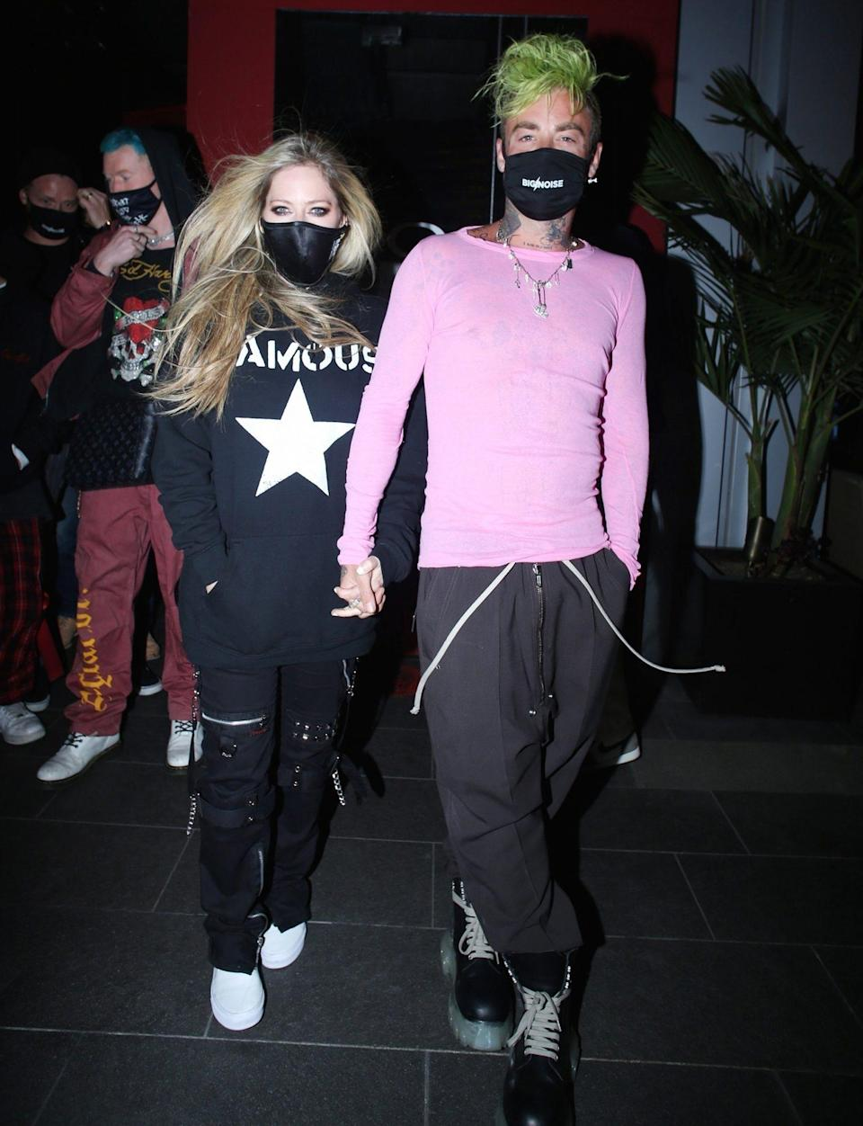 <p>Happy couple Avril Lavigne and Mod Sun leave dinner at BOA Steakhouse hand-in-hand on Saturday in West Hollywood.</p>