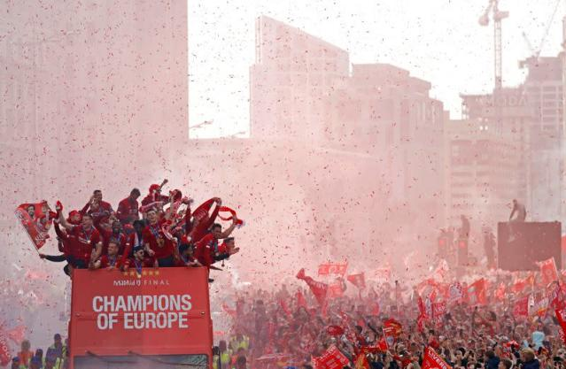 FILE PHOTO: Liverpool's team bus travels past fans during a parade in Liverpool