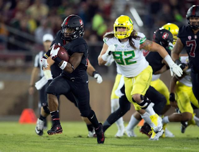 "In this Oct. 14, 2017, file photo, Stanford's <a class=""link rapid-noclick-resp"" href=""/ncaaf/players/257525/"" data-ylk=""slk:Bryce Love"">Bryce Love</a>, left, breaks free for a long touchdown against Oregon during the first quarter of an NCAA college football game in Stanford, Calif. Love tweaked an ankle against Oregon and is a game-time decision for their game Thursday, Oct. 26, 2017, against Oregon State in Corvallis, Ore . (AP Photo/D. Ross Cameron, File)"