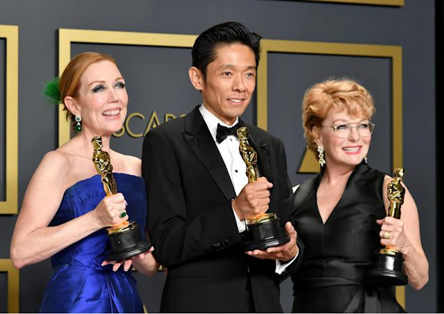 """Hairstylist Anne Morgan, special make-up effects artist Kazu Hiro, and makeup artist Vivian Baker, winners of the Makeup and Hairstyling award for """"Bombshell,"""" pose in the press room during the 92nd Annual Academy Awards at Hollywood and Highland on February 09, 2020 in Hollywood, California. (Photo by Amy Sussman/Getty Images)"""