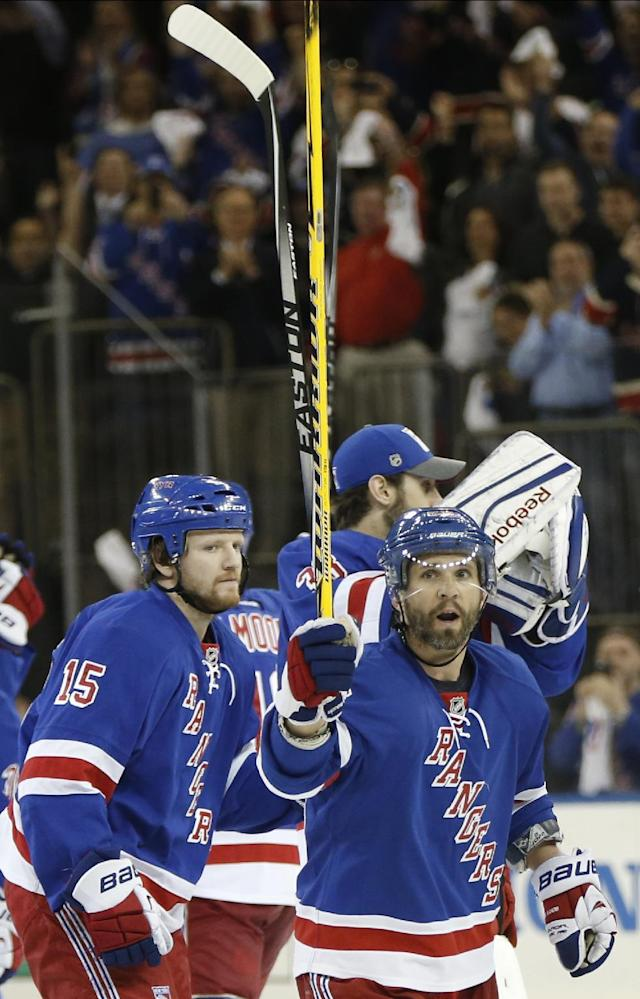 New York Rangers right wing Martin St. Louis, right, celebrates after the Rangers defeated the Pittsburgh Penguins 3-1 Game 6 of an NHL hockey second-round hockey playoff series, Sunday, May 11, 2014, in New York. St. Louis joined his team in the playoffs in the same week his mother died to help the Rangers stay alive in the playoffs, tying the best of seven series at three games a piece. (AP Photo/Kathy Willens)