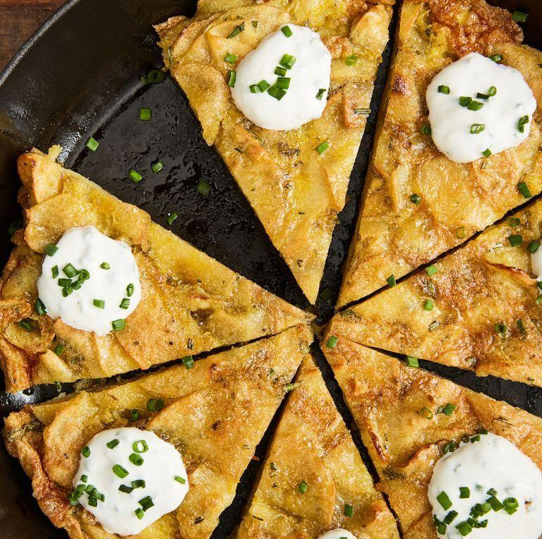 """<p>With the addition of rosemary, this simple <a href=""""https://www.delish.com/uk/cooking/recipes/a28961619/summer-frittata-sundried-tomatoes-feta-zucchini-recipe/"""" rel=""""nofollow noopener"""" target=""""_blank"""" data-ylk=""""slk:frittata"""" class=""""link rapid-noclick-resp"""">frittata</a> is much greater than the sum of its parts. Topped with garlicky, lemony sour cream sauce, it's downright delicious. </p><p>Get the <a href=""""https://www.delish.com/uk/cooking/recipes/a31128047/best-spanish-tortilla-recipe/"""" rel=""""nofollow noopener"""" target=""""_blank"""" data-ylk=""""slk:Spanish Tortilla"""" class=""""link rapid-noclick-resp"""">Spanish Tortilla</a> recipe.</p>"""