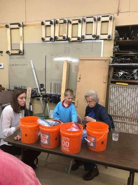 PHOTO: Tyler Sliz, 5, of Illinois, gets four generations of his family members to help build beds for children in need. He asked for bedding donations for his birthday. (Courtesy Jackie Sliz)