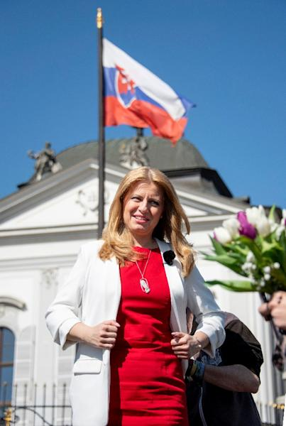 Caputova, seen outside the Presidential palace in Bratislava,is an anti-corruption activist expected to provide a check on a government tarnished after last year's murder of a journalist (AFP Photo/JOE KLAMAR)
