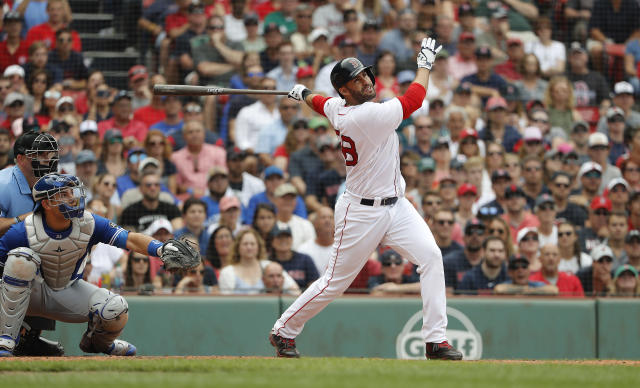 Boston Red Sox's J.D. Martinez watches a hit against the Toronto Blue Jays during the ninth inning of a baseball game Saturday, July 14, 2018, in Boston. (AP Photo/Winslow Townson)
