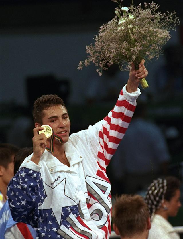 FILE - In this Aug. 8, 1992 file photo, Oscar De La Hoya, of the United States, shows off his gold medal during the award ceremony for the lightweight boxing division in the XXV Summer Olympic Games in Barcelona. De La Hoya got drunk the night he won the only boxing gold for the U.S. in the 1992 Olympics, and was still drinking when he lost his last fight to Manny Pacquiao. Now sober after a second stint in rehab he's in a fight of another kind for control of his boxing company. (AP Photo/Mark Duncan, File)