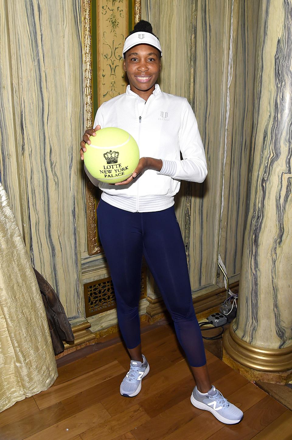 Venus posed with an oversized autograph-ready tennis ball ahead of the mini tournament.