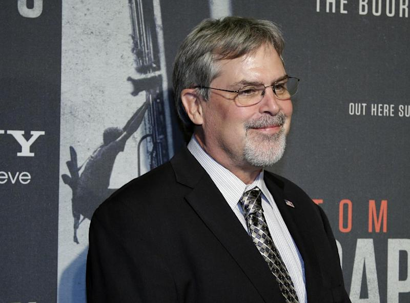 """In this Oct. 2, 2013, photo, Captain Richard Phillips, walks the red carpet at a screening for the movie """"Captain Phillips"""" at the Newseum in Washington. Dramatic accounts of the Navy SEALs rescuing the captain of an American cargo ship made headlines around the world in 2009. The military said SEAL snipers killed a trio of pirates in a tense standoff. Three shots, three kills. It was the lethal, coordinated precision that has made SEALs famous and feared. (AP Photo/Alex Brandon)"""