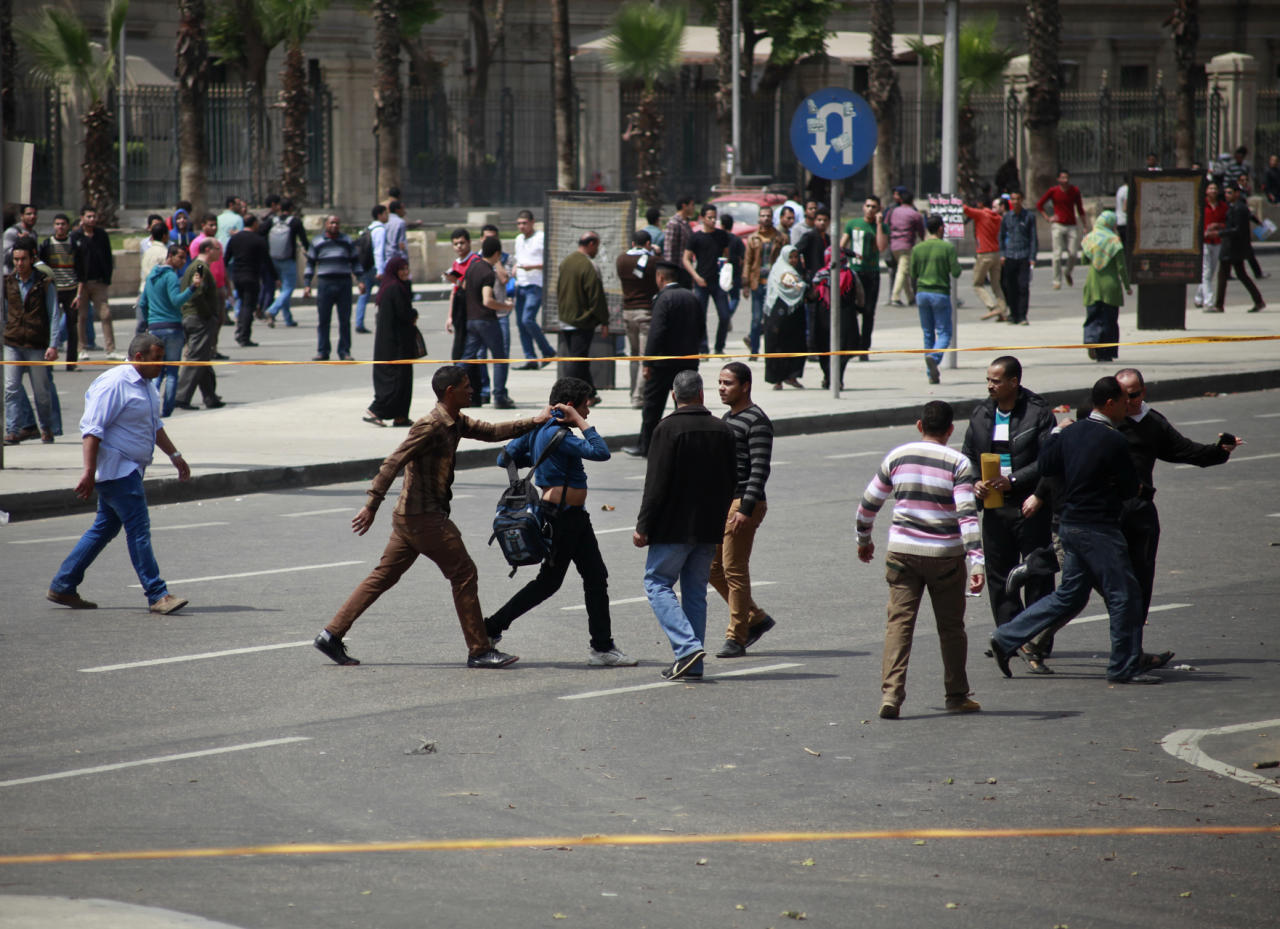 Egyptian security forces detain people at the scene after multiple explosions hit the area outside the main campus of Cairo University, killing at least two, in Giza, Egypt, Wednesday, April 2, 2014. The bombings targeted riot police routinely deployed at the location in anticipation of near-daily protests by students who support ousted Islamist President Mohammed Morsi and his Muslim Brotherhood group. (AP Photo/Sabry Khaled, El Shorouk Newspaper) EGYPT OUT