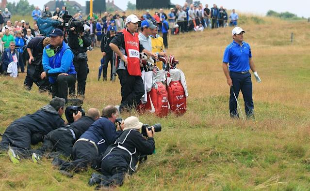 Francesco Molinari of Italy prepares to play his shot on the 11th fairway as photographers lie in wait for the shot during the third day of the British Open Golf championship at the Royal Liverpool golf club, Hoylake, England, Saturday July 19, 2014. (AP Photo/Jon Super)