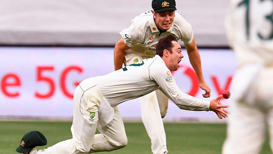 Seen here, Travis Head reacts in horror after dropping Rahane at the end of day two.