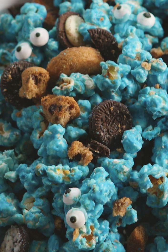 """<p>Perfect for the cookie obsessed.</p><p>Get the recipe from <a href=""""https://www.delish.com/cooking/recipe-ideas/recipes/a52683/cookie-monster-popcorn-recipe/"""" rel=""""nofollow noopener"""" target=""""_blank"""" data-ylk=""""slk:Delish"""" class=""""link rapid-noclick-resp"""">Delish</a>.</p>"""