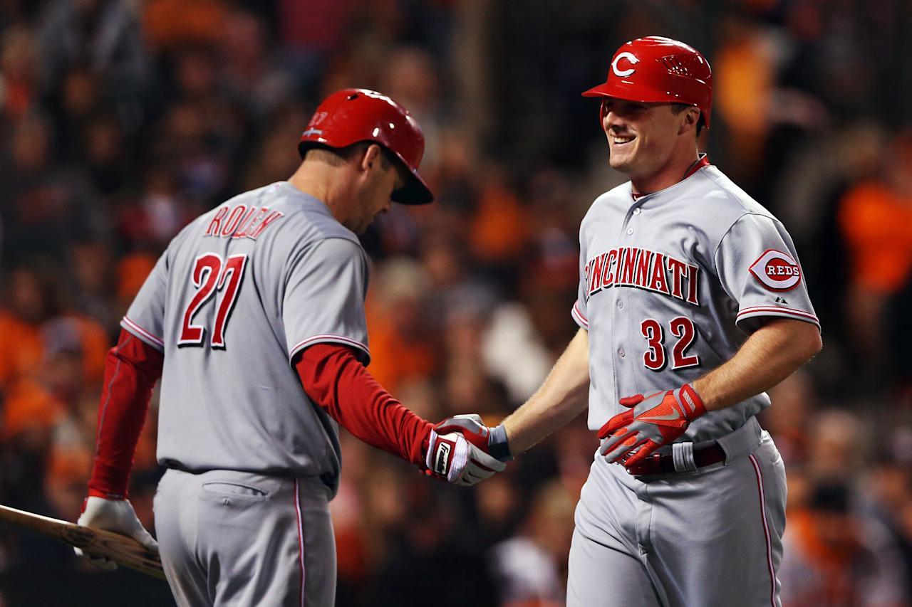 SAN FRANCISCO, CA - OCTOBER 06:  Jay Bruce #32 of the Cincinnati Reds celebrates with teammate Todd Frazier #21 after hitting a solo home run in the fourth inning against the San Francisco Giants during Game One of the National League Division Series at AT&T Park on October 6, 2012 in San Francisco, California.  (Photo by Jeff Gross/Getty Images)
