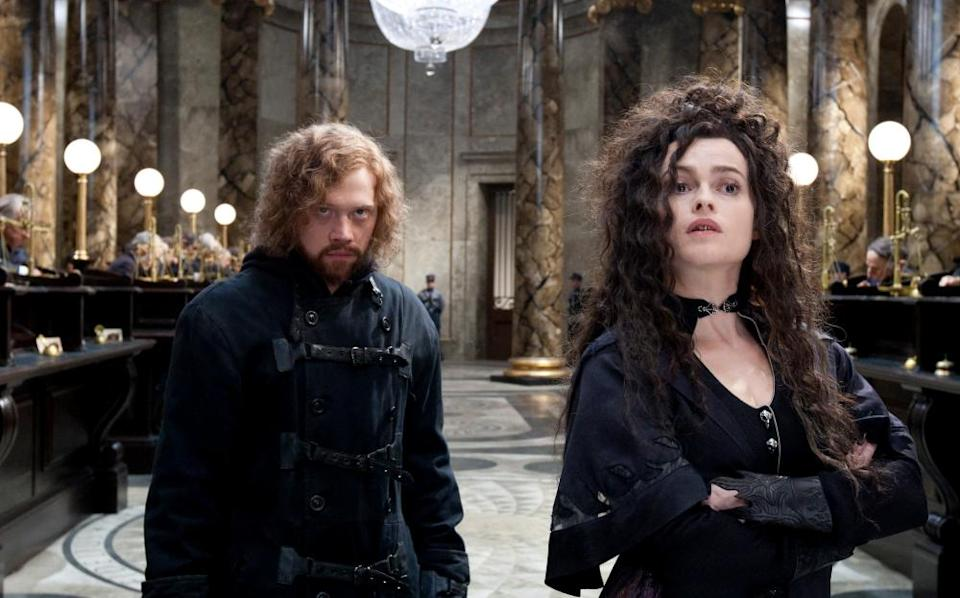 As Bellatrix Lestrange, with Rupert Grint as Ron Weasley, in Harry Potter And The Deathly Hallows: Part 2.