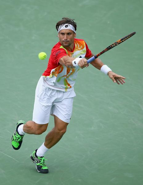 David Ferrer of Spain hits a return during his match against Julien Benneteau of France on day 8 of the Western & Southern Open on August 16, 2014 at the Linder Family Tennis Center in Cincinnati, Ohio (AFP Photo/Andy Lyons)