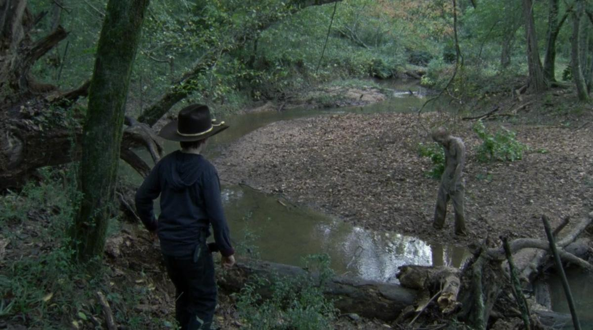 <p>In a bored and bratty mood, Carl swiped Daryl's gun and went off into the woods, where he found a walker stuck in mud. He threw rocks at it and got closer so he could shoot it, but when it got partially free and moved closer to him, he panicked, dropped the gun, and ran back to Hershel's farm. Not only did he leave the walker alive (well, undead), but he also didn't tell anyone about it … leaving it free to sneak up on Dale and kill him later in the episode.<br /><br />(Photo: AMC) </p>