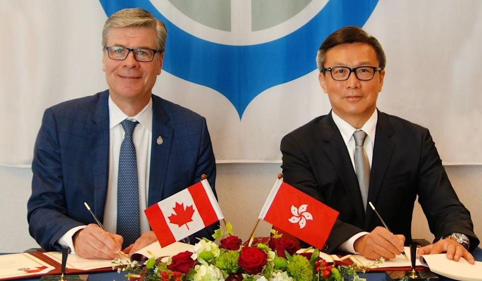Commissioner of Customs and Excise Hermes Tang (right) alongside John Ossowski at the World Customs Organisation in Brussels. Photo: Handout