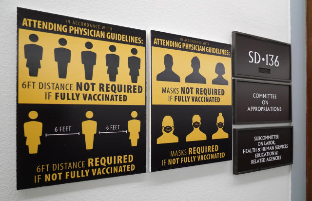 New signs displaying the updated mask policy in the Capitol complex are seen in a Senate office building, Washington, Friday, June 4, 2021. (AP Photo/J. Scott Applewhite)