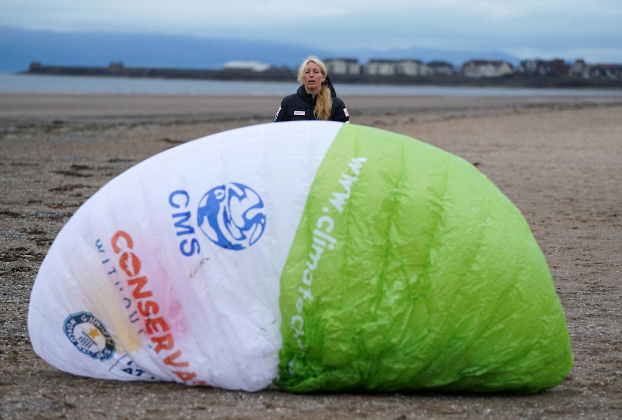 Paramotorist Sacha Dench with her glider as she checks the weather on the beach at Stevenston to see if the conditions are right for flight. Picture date: Thursday June 24, 2021. (Photo by Andrew Milligan/PA Images via Getty Images)