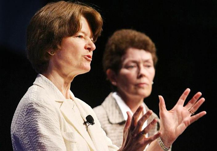 In this June 29, 2008 photo made available by the American Library Association, former astronaut Sally Ride, foreground, and Tam O-Shaughnessy discuss the role of women in science and how the earth's climate is changing during an ALA conference in Anaheim, Calif. The pioneering astronaut, who relished privacy as much as she did adventure, chose an appropriately discreet manner of coming out. At the end of an obituary that she co-wrote with her partner, Tam O'Shaughnessy, they disclosed to the world their relationship of 27 years. As details trickled out after Ride's death on Monday, July 23, 2012, it became clear that a circle of family, friends and co-workers had long known of the same-sex relationship and embraced it. For many millions of others, who admired Ride as the first American woman in space, it was a revelation - and it sparked a spirited discussion about privacy vs. public candor in regard to sexual orientation. (AP Photo/American Library Association, Curtis Compton)