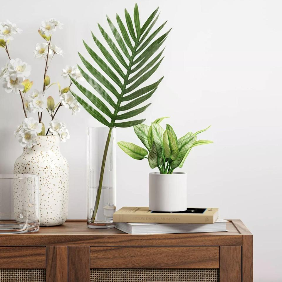 <p>This <span>Threshold Artificial Variegated Leaf Arrangement </span> ($5) will polish up any corner in your home.</p>