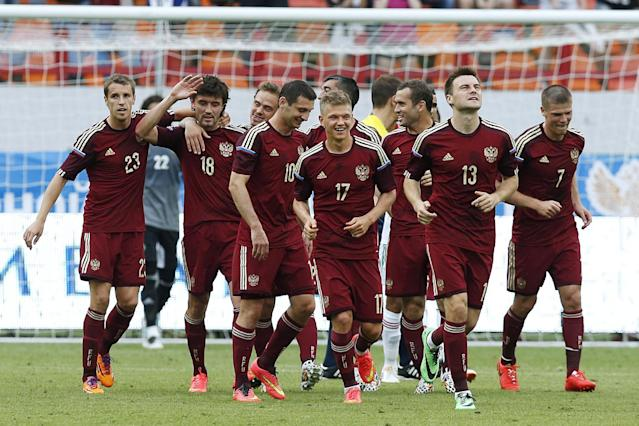 Russian national soccer team players celebrate a goal during a friendly soccer match against Morocco in Moscow, Russia, Friday, June 6, 2014. Russia won 2-0. This is the last friendly match before Russia team leave for Brazil to compete in the World Cup. (AP Photo/\Name\)