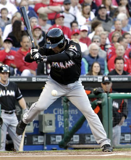 Miami Marlins' Placido Polanco is hit by a pitch from the Philadelphia Phillies in the first inning of a baseball game Saturday, May 4, 2013, in Philadelphia. (AP Photo/H. Rumph Jr)