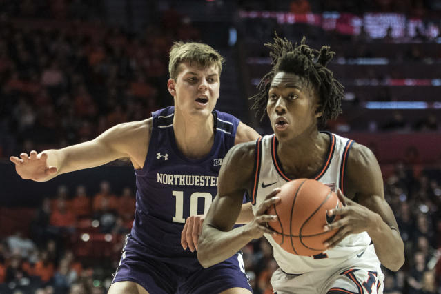 Illinois' Ayo Dosunmu (11) looks for an open shot as Northwestern's Miller Kopp (10) defends in the first half of an NCAA college basketball game, Saturday Jan. 18, 2020, in Champaign, Ill. (AP Photo/Holly Hart)