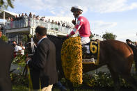 Flavien Prat atop Rombauer heads to the winner's circle after winning the Preakness Stakes horse race at Pimlico Race Course, Saturday, May 15, 2021, in Baltimore. (AP Photo/Will Newton)