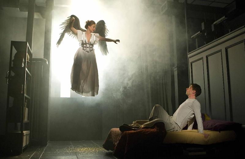 "In this publicity image released by Boneau/Bryan Brown, Robin Weigert, left, and Christian Borle are shown in a scene from Tony Kushner's ""Angels in America."" (AP Photo/Boneau/Bryan Brown, Joan Marcus)"