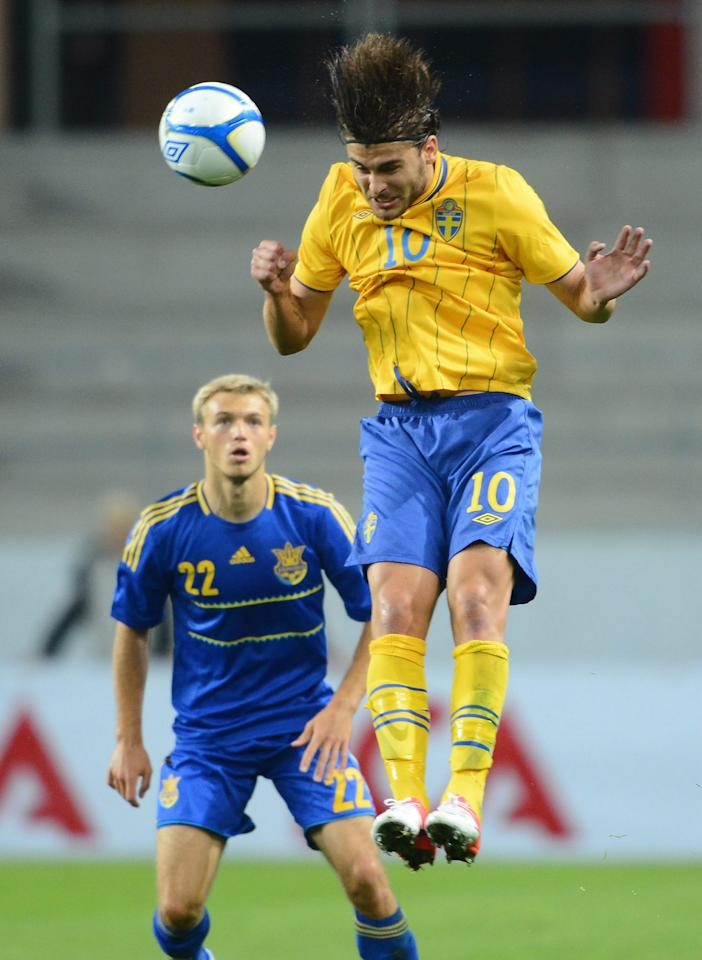 Sweden's Astrit Ajdarevic (R) jumps for a header in front of Ukarine's Dmutro Grechyshkin during the U21 European Football Championships qualification match in Kalmar on September 10, 2012.  AFP PHOTO/SCANPIX/ Patric SoderstromPatric Soderstrom/AFP/GettyImages